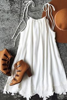 white sun dress for summer with stacked heel bootie with cut outs.