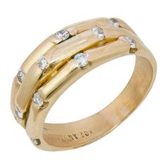 Tiffany & Co. Diamond Gold Bamboo Ring. Circa 1980s Tiffany & Company 18K Yellow Gold Bamboo Style Ring. Set with 11 Full Cut Round Diamonds Totaling .25 Carat