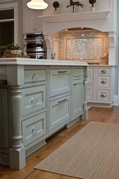 lovely robins egg kitchen island with amazing storage!
