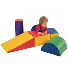 """Made of school quality durable, vinyl-covered foam, these soft, sturdy Play Forms give pre-schoolers climbing, rolling and sliding fun. Lightweight enough for even toddlers to arrange and re-arrange for gymnastic challenges, they will withstand their toughest workout. Ramp measures 24""""L x 16""""W x 8""""H down to 1""""H. Wipe-clean vinyl in primary colors. Made in U.S.A. Sorry, no gift wrap or Express Delivery. Toddler toys - Ages 1 yrs. +."""