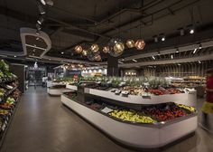 Spar supermarket displays groceries between curved wooden ribs