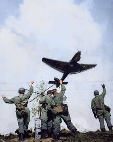 The picture shows German Fallschirmjäger waving to a passing Junkers Ju 87 dive bomber, during the Battle of the Netherlands, part of the…