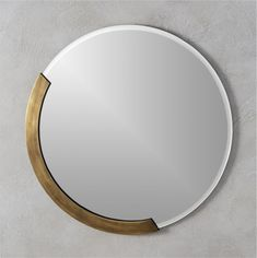 Simple hand-beveled round reflects edgy glamour in a semi circle of antiqued brass. Cool vintage store vibe is just the thing to add an upscale bit of personality.