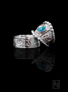 "Make it a RimRock™ A Turquoise Wedding Ring for the Country Lovin' Lady Say ""I love you"" with this stunning his and her Country Love Forever Ring Set by Hyo Silver.  Incorporate blue turquoise in your wedding ring or choose from a variety of turquoise colors or RimRock™ selections.  Browse choices in the ordering form!  Her Ring Dimensions: 3/4 in. Front Band Width and  1/8 in. Back Band Width.  Picture shows the following options for her ring:  Vintage Engraved Scrolls, Rose Gold Lett..."