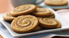 Gingerbread Pinwheels ~ Get a quick start with Pillsbury® refrigerated gingergread and sugar cookie dough to make these spicy two-toned pinwheel cookies. Pillsbury Sugar Cookies, Pillsbury Recipes, Sugar Cookie Dough, Cookie Desserts, Just Desserts, Cookie Recipes, Dessert Recipes, Refrigerated Cookie Dough, Pillsbury Dough
