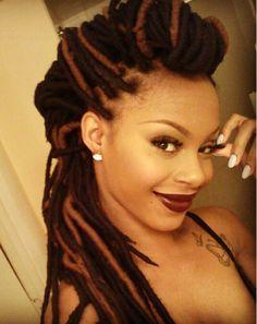 Love her yarn braids ;)