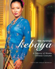 Nyonya in kebaya and silk, tulis batik sarong.