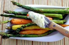 Roasted Asparagus & Baby Carrots With Chive Butter: A little color and a little chive butter make this a satisfying side or main. Get the recipe. Photo: Poor Girl Eats Well.
