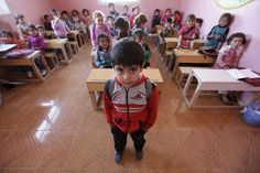 Five-year-old Yousef Madr al-Ajaj poses inside a classroom in the rebel-controlled area of Maarshureen village in Idlib province, Syria March 12, 2016. REUTERS/Khalil Ashawi