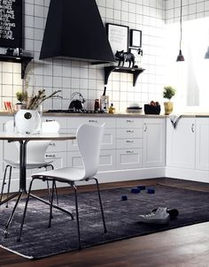 SR - black and white.  Nice use of square tiling and fantastic oven hood.