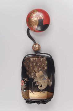 Manju netsuke with design of water-buffalo and peony | Ojime with design of toys 19th century ,Museum of Fine Arts, Boston