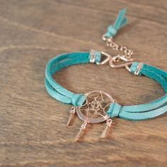 Fresh on the shop today I have two new bracelets that are close to my heart. This little dreamcatcher bracelet comes in rose gold with turquoise leather as pictured here and in sterling silver with dark chocolate leather. I make each little dreamcatcher from precious metal wire. The web is woven by hand so no two are exactly alike. The total height of the dreamcatcher is 1 1/8 inch including the 'drops' that hang below it and the width is 3/4 inch. At the sides are soft deer hide leather and…