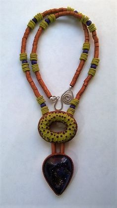 Polymer clay necklace with purple druzy by Shelley Atwood. See more at shelleyatwood.com