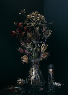 Beautifully depressing flower arrangement by Jeanne-Rose, Dior Midnight Poison. #FlowerShop