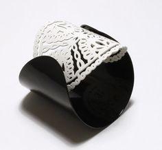 Cuff | Ashley Buchanan.  Brass with powder coated cream and black