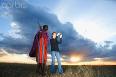 Maasai tribesman standing with tourist in the Maasai Mara game reserve, Kenya Rich Image, Music Licensing, Game Reserve, Photo Library, Kenya, Royalty Free Images, Vector Art, Unity, Warriors
