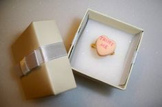 """Candy Heart Ring - make it into a bridal shower game.  each person gets a candy heart ring and you draw hearts and whoever has that phrase gets the prize!  """"Love is Sweet"""" themed bridal shower"""