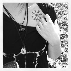 Vegvisir (Icelandic compass). Different placement. Viking stave or rune to help guide the wearer through the storms.