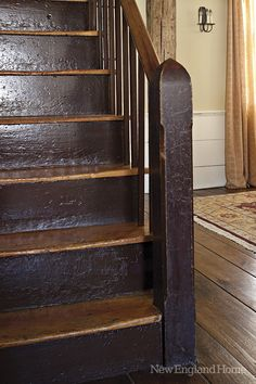 The wooden stairs to the second floor serve as a reminder of this home's past.