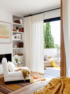 Oasis by the sea: villa in sunny Spain #bedroom #cozy #idea #Inspiration #curtain #french #window #terrace #bedding #yellow #summer #sun