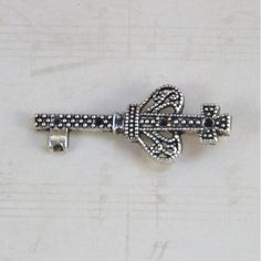 Silver Crown Cross Key deviskeys.com  .35 cents a key  Beautiful charm for necklace. 1 – 1/2 Inch. Weight .01 Great charm for bracelet. earring's or a necklace 1 – 1/2 Inch. Weight .01  This is a favorite with Church's and Christians, because of the cross. Great sweet 16, or Alice in wonderland. Comes in 3 colors.