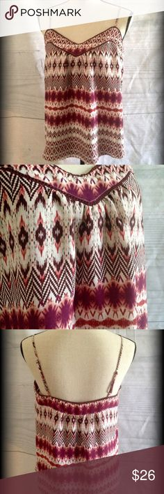 Beautiful Jessica Simpson Tribal top Two adjustable skinny straps. Top is trimmed in crochet designs. Scooped shirttail in front, straight across back at bottom. Nice lightweight flowy material. Jessica Simpson Tops
