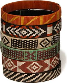 These beautiful bracelets are crafted by some of the remaining Zenu Indians of Colombia. They braid strips of caña flecha, a durable palm, that has been used by their ancestors for centuries. These folks are loyal to their cultural legacy but had been stripped of their riches, lands and possessions by colonial settlers. They're using their ancestor's pre-Columbian weaving techniques to create jewelry for you with contemporary designs.