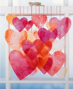 Cool Heart Garland Ideas for Valentines Day- You take crayon shavings of your choice, place them between two pieces of wax paper, and then, with a protective piece of paper or fabric, iron the sheets until the crayons melt. Cut out the hearts you want and hang with string.