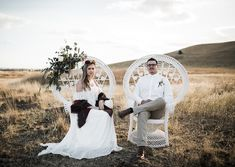 bride + groom in white wicker chairs with floral accent #styledwedding #weddingshoot