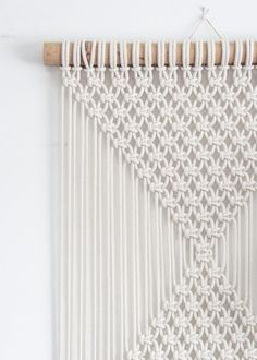 ***SALE*** 20% OFF WHEN YOU SPEND £50 OR MORE JUST USE COUPON CODE BARGAINYESPLEASE AT CHECK-OUT  This macrame wall hanging is hand-knotted using 100% cotton cord (braided, 5mm) in natural ecru with a bamboo supporting rod.  Approx Dimensions >  Bamboo Width: 56cm / 22 inches Weaving Width: 51cm / 20 inches Length: 194cm / 76 inches