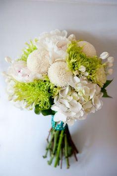 White pom pom dahlias or zinnias, green spider mums, white hydrangea and greenery