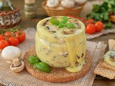 Processed, homemade NATURAL cheese with mushrooms / Culinary Universe