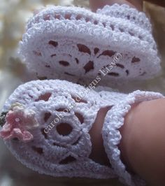 Beautifully elegant flower sole booties for babys special day    Uses 4 ply cotton yarn (approx 30 grams) and will fit from birth to 6 months.  $5.80