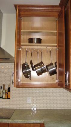 hanging pot rack in cabinet
