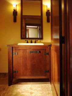 not a bad interpretation of a Craftsman bathroom vanity... clean, simple, chunky... i like the exposed / blackened / hand-forged-looking butterfly hinges... finish looks fumed (though it probably isn't)... not bad