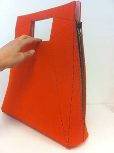 Felt bag with zippers.