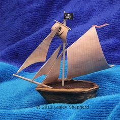 Bermuda Sloop pirate ship with a walnut shell hull and printable miniature sails.