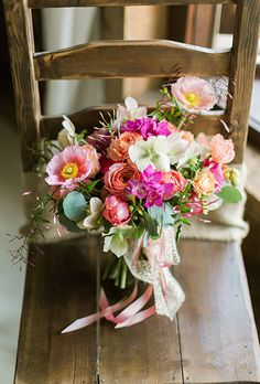 Brides.com: How Much Do Wedding Bouquets Really Cost?. Bouquet of poppies, romantic antique garden roses, helleborus, parrot tulips, ranunculuses, freesia, phalaenopsis orchids, jasmine vine, and silver dollar eucalyptus, $325, Sebesta Design