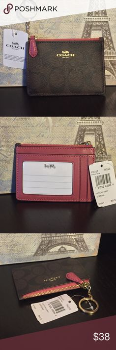 """Coach ID Case Signature coated canvas.  Accent colors are mauve and light gold.   There is 1 credit card slot and an ID window.  Zip-top closure.  Inside is fabric lined and Cain be used for coins, folded bills, etc.  4.25"""" long and 3"""" high.    Bundle two or more items from my closet to save on shipping.    Let me know if you have any questions! Coach Bags Wallets"""