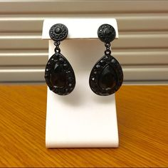 Black Rhinestone Earrings Very classy jewelry. Black metal hardware with black faceted rhinestones. The style is somewhat vintage and the coloring adds a modern touch for a nice contrast. Post style, butterfly backs included (not pictured). Open to reasonable offers! Jewelry Earrings