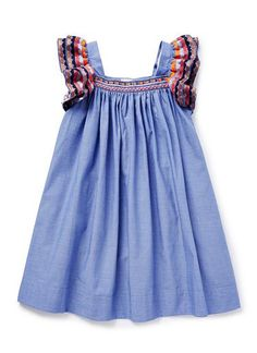 100% Cotton Dress. Short sleeve chambray dress. Featuring double layered embroidered sleeves and yoke. Available in Chambray.