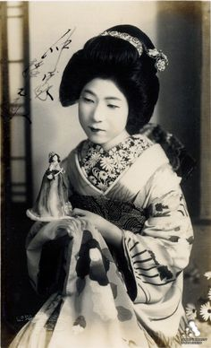 Geisha with a doll