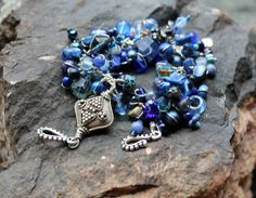 blue hues. lapis lazuli bracelet. tibetan focal by UniqueNecks