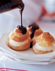The ultimate Valentines' Day dessert- Profiteroles!! Cream puffs, cold vanilla ice cream, and a decadent warm chocolate sauce.