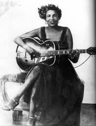 """Memphis Minnie - blues guitarist, song writer and singer. Born 1897 as Lizzie Douglas.  Famous for songs such as """"Bumble Bee"""", """"Hoodoo Lady"""", and """"I Want Something For You"""".   She died on August 6, 1973."""