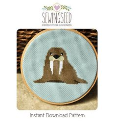Walrus Cross Stitch Pattern available for instant download via Etsy.    Pattern Details:  This pattern is in PDF format and consists of an example
