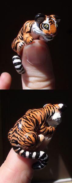 http://fc04.deviantart.net/fs71/f/2013/167/5/3/mini__thumb__tiger_by_kingmelissa-d69am68.png