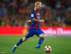 Lionel Messi of FC Barcelona runs with the ball during the Joan Gamper trophy…