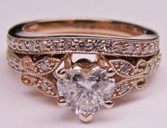 Rose Gold Engagement Ring Colored and butterflies...with a heart shaped stone...love it