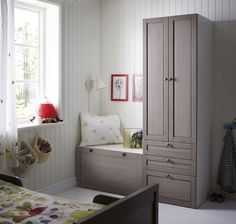 ikea wardrobe and chest makes cozy reading area
